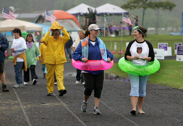 Gloucester: Amanda Osier and Kelly Francis, right, both of Gloucester walk the track at Newell Stadium during the annual Relay for Life Friday afternoon.  The theme for this leg of the walk was Beach Party where participants could sport their crazist beach attire. Relay for life is an 18 hour walk where members of your team take turns walking the track all to raise money for the American Cancer Society.  Mary Muckenhoupt/Gloucester Daily Times