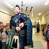 Rockport: Students at Rockport Elementary School line the halls as Patrick Cheney, a member of the Peabody Fire Pipes and Drums Band, makes a tour through the halls after doing a presentation to 5th graders, who have been studying Scotland. The event was organized by Rockport Music. Photo by Kate Glass/Gloucester Daily Times Monday, June 15, 2009