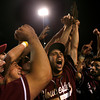 Lowell: Gloucester's Ross Carlson raises the Division I North Championship trophy after the Fishermen defeated St. John's Prep 8-7 at LeLacheur Park in Lowell on Saturday night. Photo by Kate Glass/Gloucester Daily Times Saturday, June 6, 2009