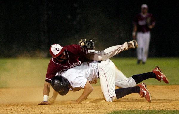 Lowell: Gloucester's Ryan Cusick hangs onto the ball as he gets Lincoln Sudbury's Derek Lowe out at second base in the Division I North Semi-Finals against Lincoln-Sudbury last night. Photo by Kate Glass/Gloucester Daily Times Thursday, June 4, 2009