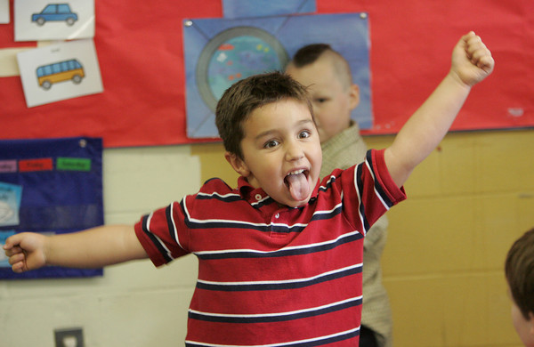 Gloucester: Lucas Argentino, 4, freezes while playing freeze dance with his classmates in Cristina Thomas' pre-school classroom at Fuller School Thursday afternoon.  The class held it's graduation ceremonies which also included singing and ice cream sundeas for friends and family. Mary Muckenhoupt/Gloucester Daily Times