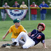Manchester Essex's Parker Edington tags Peabody West's Michael Petrosino out at second base during the District 15 Little League All-Star Tournament at Stage Fort Park last night. Photo by Kate Glass/Gloucester Daily Times Monday, June 29, 2009