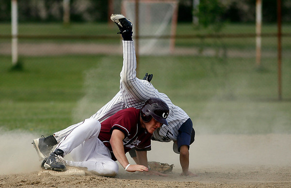 Gloucester: Gloucester's Conor Ressel knocks over Lawrence's Tito Luberes as he steals second base in the second round of the North Division I tournament yesterday. Photo by Kate Glass/Gloucester Daily Times Monday, June 1, 2009