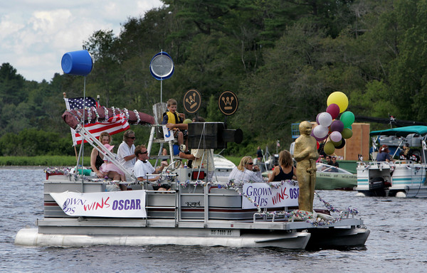 """Essex: A boat decorated for the movie """"Grown Ups"""" filming in Essex participates in the annual Forth of July boat parade around Chebacco Lake as seen from Camp Menorah in Essex Saturday afternoon.   Mary Muckenhoupt/Gloucester Daily Times"""