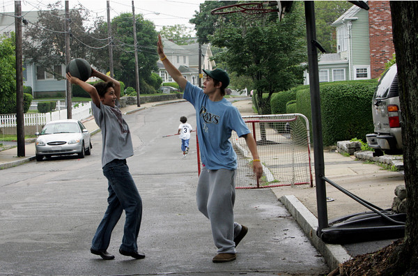 Gloucester: Noah Carlson, 11, left, plays a game of one-on-one with his cousin Coltyn Rivas, 15, on Riverdale Avenue Friday afternoon.  Mary Muckenhoupt/Gloucester Daily Times