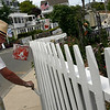 Rockport: John B. Kelley paints the picket fence outside his home along Front Beach yesterday afternoon. He was hoping to finish in time to watch his grandson pitch in a little league game. Photo by Kate Glass/Gloucester Daily Times Wednesday, June 3, 2009