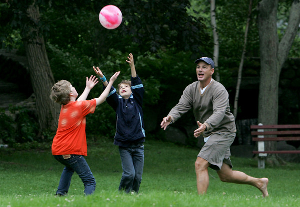 Rockport: From left, Joshua Kennedy, 12, Kyle Doucette, 7, and Larry Kennedy, all run to catch a ball the was kicked into left field during a game of kickball at Millbrook Meadow Tuesday afternoon.  Mary Muckenhoupt/Gloucester Daily Times