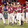 Brockton: Members of the Gloucester baseball team greet Ryan Cusick at home plate following his two-run home run in the 9th inning, but the rally was short lived and they fell 8-3 to BC High in the State Semi-Finals at Campanelli Stadium in Brockton last night. Photo by Kate Glass/Gloucester Daily Times Wednesday, June 10, 2009