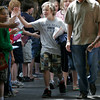 Rockport: Thomas Boucher high fives his schoolmates as he leads the procession of 5th graders through Rockport Elementary School during their last day of school yesterday. Photo by Kate Glass/Gloucester Daily Times Tuesday, June 16, 2009