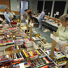 Gloucester: Friends of the Sawyer Free Library, including Nancy Harrison, right, set up for the library's annual benefit book sale Wednesday afternoon. The book sale is held on Saturday for the public with a preview sale Thursday for the friends of the library. Mary Muckenhoupt/Gloucester Daily Times