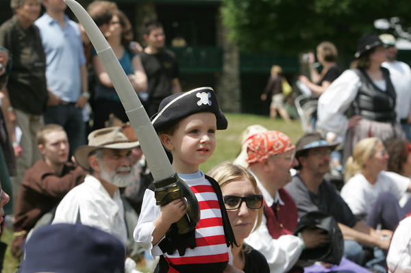 Gloucester: William Wildfire, 3, watches a pirate fight put on at annual New England Pirate Faire at Stage Fort Park Saturday afternoon. The festival included a variety of events including musicians, interactive plays, puppeteers, magicians and a Tortuga marketplace Mary Muckenhoupt/Gloucester Daily Times