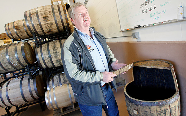 Gloucester: Bob Ryan, co-owner of Ryan & Wood Inc., Distilleries, talks about how barrels change the flavor and taste of alcohol. Photo by Kate Glass/Gloucester Daily Times Tuesday, June 16, 2009