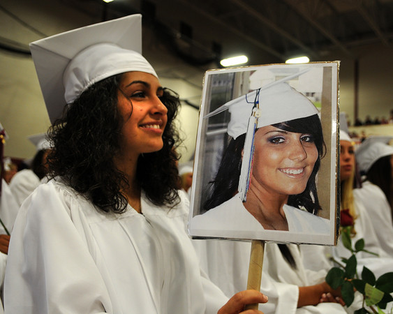 Gloucester: Mercedes Lane holds a photo of her friend Jessica Maletti, who was unable to attend Graduation for medical reasons Sunday afternoon at the Benjamin Smith Feild House. Desi Smith Photo/ Gloucester Daily Times.June 14,2009