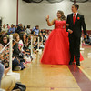Gloucester: Gloucester senior Raquel Shaw and her date Freshman Lenny Taormina walk around Benjamin A. Smith Fieldhouse during the promenade Thursday evening. Mary Muckenhoupt/Gloucester Daily Times