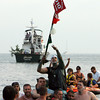 Gloucester: Stew McGillivray gets carried onto Pavilion beach after winning the greasy pole for the third year in a row Sunday.  Mary Muckenhoupt/Gloucester Daily Times