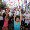 Gloucester: Juliana Freed, center, and Piera Locontro, left, try to catch the confetti at the end of the procession of St. Peter yesterday afternoon. Photo by Kate Glass/Gloucester Daily Times