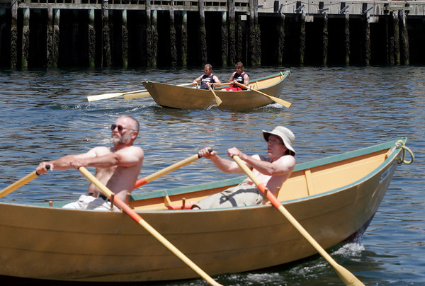 Gloucester: John Swift and Mick Cote of the USA, rear, had a solid lead over Canada's Ken MacDonald and Tim Mair as they approached the finish line of the senior's division race in the International Dory Boat Races at the Jodrey State Fish Pier on Saturday. Photo by Kate Glass/Gloucester Daily Times