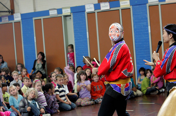 Gloucester: Mark Rooney and Juni Kobayashi of Odaiko New England perform for students at West Parish Elementary School Thursday morning. The Japanese drumming came to the school too perform drumming and storytelling and also let some kids come up and drum. Mary Muckenhoupt/Gloucester Daily Times