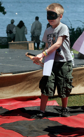 Gloucester: Jake Lyons, 6, pulls out a crossbow as a challenge is issued during a game of Pirate Checkers at the New England Pirate Faire at Stage Fort Park on Saturday. The fair will also run June 26-27th from 10-5. Photo by Kate Glass/Gloucester Daily Times