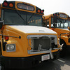 Manchester: Two unused school buses sit behind Manchester Town Hall waiting to be sold. Mary Muckenhoupt/Gloucester Daily Times