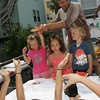 Gloucester: Joe Palmisano holds up the winner of the little kids watermelon eating contest, Madison Moseley, 4, during the children's games held at Beach Court Saturday. Mary Muckenhoupt/Gloucester Daily Times