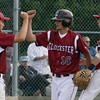 Gloucester: Gloucester pitcher Lucas Ilges, left, and Jimmy Nicolosi, right, congratulate Lucas DaSilva as he crosses the plate on a single hit by Brett Cahill to take the lead over Dracut in the 5th inning of the Quarter Finals of the MIAA North Division 2 Baseball Tournament at Nate Ross Field yesterday. Photo by Kate Glass/Gloucester Daily Times