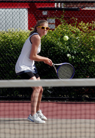 Gloucester: Triton's Sydney White returns a serve to Gloucester's Mary Unis during the Quarter Finals of the MIAA Division 2 North Tennis Tournament at Gloucester High School yesterday afternoon. Photo by Kate Glass/Gloucester Daily Times