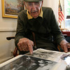 Rockport: Wayne Morrell, a local artist of more than a half a century, looks through some of his favorite sketches at his Rockport gallery. Morrell will be holding an open house at his gallery on sunday, June 13 from 1 p.m. to 5 p.m. Photo by Kate Glass/Gloucester Daily Times
