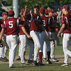 Gloucester: Gloucester's Adam Philpott high fives teammate Caulin Rogers as they celebrate the Fishermen's 7-6 win over Dracut in the Quarter Finals of the MIAA North Division 2 Baseball Tournament at Nate Ross Field yesterday. Photo by Kate Glass/Gloucester Daily Times