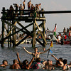 Gloucester: Greasy pole winner Joe Brancaleone gets carried onto Pavilion Beach after getting to the flag in the second round of Friday night's greasy pole. Mary Muckenhoupt/Gloucester Daily Times