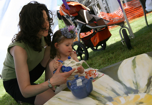 """Essex: Olivia Pester, 3, of Gloucester gets a hand pouring her """"tea"""" during the 7th Annual Fairy Festival at Underwood Photography in Essex on Saturday. Photo by Kate Glass/Gloucester Daily Times"""