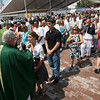 Gloucester: Hundreds of people line up to receive communion during the Mass of St. Peter at St. Peter's Square yesterday morning. Photo by Kate Glass/Gloucester Daily Times