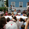 Gloucester: Parents get out their cameras to take pictures of the little kids watermelon eating contest run by Joe Palmisano, right, at Beach Court Saturday afternoon. Mary Muckenhoupt/Gloucester Daily Times