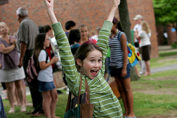 Gloucester: Sophie Trumbour, 11, cheers for the last day of school when she sees her dad after being dismissed from Rockport Elementary School Thursday afternoon.  Sophie said she was excited for the going to the beach this summer as well as starting middle school in the fall. Mary Muckenhoupt/Glocuester Daily Times