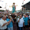 Gloucester: People gathered in St. Peter's Square throw confetti at the statue as it passes by and is carried up to the altar during the opening ceremonies for St. Peter's Fiesta on Friday evening. Mary Muckenhoupt/Gloucester Daily Times