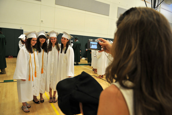 Manchester: Journalism Teacher Mary Buckley Harmon takes a picture of former students Sophie Hagberg, Bobina Vander Laan, Julia Melamed and Skylar Coons at the Manchester Essex Regional High School Gym. Photo by Desi Smith/Gloucester Daily Times
