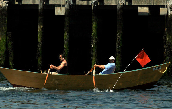 Gloucester: John Scola and Mike Harmon had a clean turn, which helped them defeat Canada's Rob Hulburt and Angus Atkinson during the International Dory Boat Races at the Jodrey State Fish Pier on Saturday. Photo by Kate Glass/Gloucester Daily Times