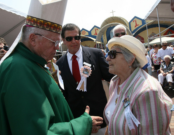 Gloucester: Al Millefoglie watches as Bishop Frank Irwin blesses his mother, Antonia Millefoglie, following the Mass of St. Peter yesterday morning. Photo by Kate Glass/Gloucester Daily Times