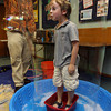 "Gloucester: Eli Mueller, 6, of Rockport blows a bubble while inside a bubble created Mike Dorval, the ""Boston Bubble Guy,"" at the Sawyer Free Library on Tuesday morning. Photo by Kate Glass/Gloucester Daily Times"