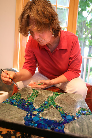 Rockport: Pam Stratton works on a mosaic table at her Rockport studio. Stratton is one of four new artisans on the Cape Ann Artisans 2010 Open Studio tour, which is June 19-20 from 10-5. Photo by Kate Glass/Gloucester Daily Times