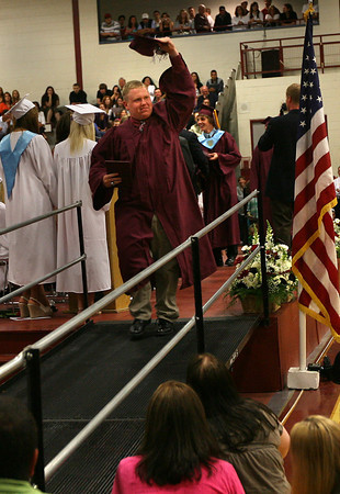 Gloucester: Kyle Jenkins tips his cap to the crowd after receiving his diploma during Gloucester High School's graduation ceremony in the Benjamin A. Smith Fieldhouse yesterday afternoon. Photo by Kate Glass/Gloucester Daily Times