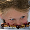 Gloucester: Sophia Pregent, 6, looks up at the crowd while eating her blueberry pie durng the pie eating contest at Beach Court Saturday afternoon. Mary Muckenhoupt/Gloucester Daily Times
