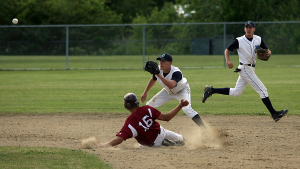 Gloucester: Gloucester's Gilbert Brown safely steals second base as Dracut's Nicholas Goodin gets a late throw in the Quarter Finals of the MIAA North Division 2 Baseball Tournament at Nate Ross Field yesterday. Photo by Kate Glass/Gloucester Daily Times