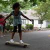 Rockport: Nadia Robertson skateboards down Mt. Locust Street on Wednesday afternoon. Robertson had been riding a scooter earlier and switched to the skateboard. Photo by Kate Glass/Gloucester Daily Times