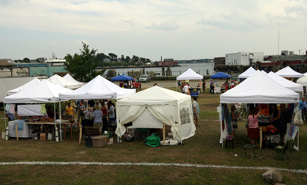 Gloucester: The Cape Ann Farmer's Market opened at the I-4, C-2 property on Rogers Street yesterday afternoon. Photo by Kate Glass/Gloucester Daily Times