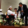 Gloucester: Gloucester High School Principal William Goodwin presents a diploma to Sarah Archer and her dog, Ballou, dressed in a Class of 2010 hat, during Gloucester High School's graduation ceremony in the Benjamin A. Smith Fieldhouse yesterday afternoon. Photo by Kate Glass/Gloucester Daily Times