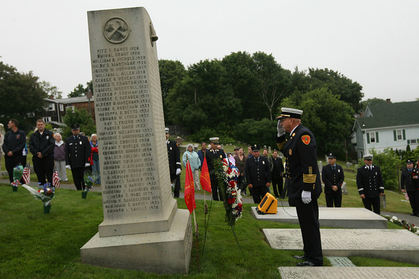 Gloucester: Gloucester Fire Chief Phil Dench salutes after placing a wreath in front of the Firefighters Memorial as the department honors those who have passed away during the Firefighters Memorial Service held Sunday morning at Cherry Hill Cemetery. Photo by Kate Glass/Gloucester Daily Times