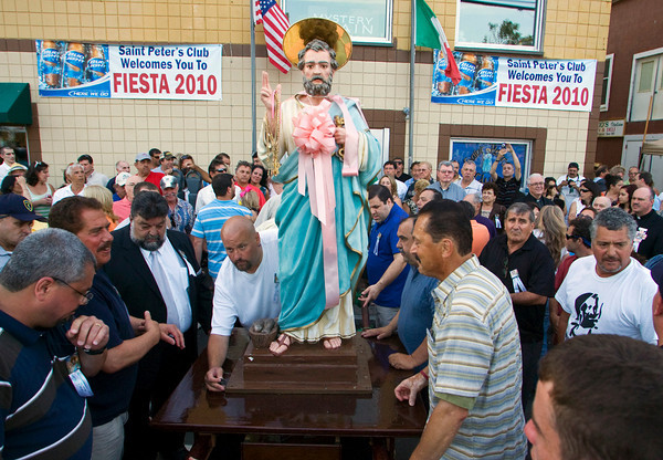 Gloucester: The St. Peter statues gets ready to be carried to the alter at St. Peter's Square before the openening ceremonies begin in front of St. Peter's Club Friday night. Mary Muckenhoupt/Gloucester Daily Times
