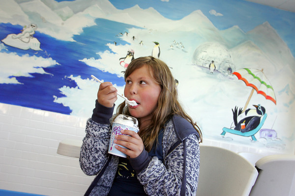 Gloucester: Olivia Danjou, 10, enjoys her ice cream at Igloo, a new ice cream place on Railroad Avenue, Wednesday evening. Mary Muckenhoupt/Glocuester Daily Times