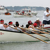 Gloucester: The Neighborhood comes barreling into Pavillion Beach winning the junior seine boat race Saturday. The scuttler, right, is Keith Palazzola and coxswain is Sammy Scola. Mary Muckenhoupt/Gloucester Daily Times